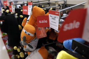 Photo - In Thursday, Nov. 28, 2013, photo, slippers are sold at a Kmart in New York. The Labor Department releases Consumer Price Index for December on Thursday, Jan. 16, 2014.  (AP Photo/Julio Cortez)