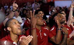 Photo - OU players learn they will play North Dakota State in the NCAA Tournament.                    Photo by Sarah Phipps, The Oklahoman