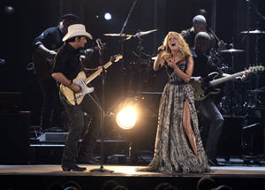 "Photo - Brad Paisley, left, and Carrie Underwood perform ""Remind Me"" during the 45th Annual CMA Awards in Nashville, Tenn., on Wednesday, Nov. 9, 2011. (AP Photo/Mark Humphrey) ORG XMIT: CASH280"
