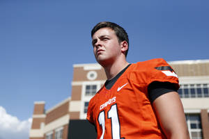 photo - OKLAHOMA STATE UNIVERSITY / OSU / COLLEGE FOOTBALL: Quarterback Wes Lunt waits to have his picture taken during Oklahoma State's football media day in Stillwater, Okla., Saturday, Aug. 4, 2012. Photo by Sarah Phipps, The Oklahoman