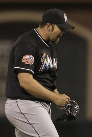 Photo -   Miami Marlins pitcher Heath Bell (21) celebrates after the final out during the ninth inning of a baseball game against the San Francisco Giants in San Francisco, Tuesday, May 1, 2012. The Marlins won 2-1. (AP Photo/Jeff Chiu)