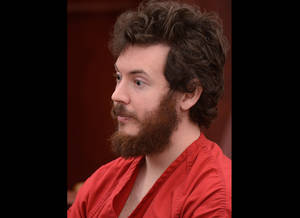 Photo - FILE - James Holmes, Aurora theater shooting suspect, sits in the courtroom during his arraignment in Centennial, Colo., in a Tuesday, March 12, 2013 file photo. Holmes' lawyers plans to ask a judge on Monday, May 13, 2013 to enter a plea of not guilty by reason of insanity, a move that is widely seen as Holmes' best hope of avoiding the death penalty. (AP Photo/Denver Post, RJ Sangosti, Pool, File)