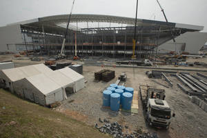 Photo - FILE - This April 9, 2014 file photo shows construction at the Itaquerao stadium in Sao Paulo, Brazil. The stadium is slated to host the World Cup opener match between Brazil and Croatia on June 12. About 20,000 temporary seats are being installed behind the goals to increase the stadium's capacity to nearly 70,000.  (AP Photo/Andre Penner, FIle)