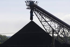 Photo - A hill of coal is seen at the North Omaha Station, a coal-burning power station, in Omaha, Neb., Monday, June 2, 2014. The Obama administration on Monday unveiled a plan to cut earth-warming pollution from power plants by 30 percent by 2030, setting in motion one of the most significant actions to address global warming in U.S. history. (AP Photo/Nati Harnik)