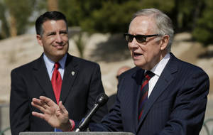 Photo - Senate majority leader Harry Reid, right, speaks at a news conference,Thursday, March 20, 2014, in Las Vegas. Reid and Nevada governor Brian Sandoval, left, talked about a new report which shows at least $5.5 billion has been invested in Nevada's clean energy sector since 2010. (AP Photo/Julie Jacobson)
