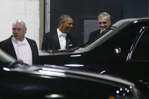 Photo - President Barack Obama walks with Chief of Staff Denis McDonough, right, as they leave the Gridiron Dinner through a loading area at a hotel in Washington, Saturday, March 9, 2013. (AP Photo/Charles Dharapak)