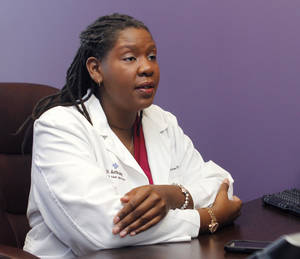 Photo - Dr. Kertrisa McWhite discusses what it's like to receive a mastectomy. McWhite is a surgical breast oncologist in Oklahoma City. PHOTO BY PAUL HELLSTERN,  THE OKLAHOMAN