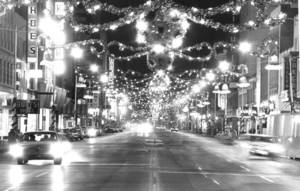 Photo - If OKC Central business columnist Steve Lackmeyer were to play the role of Santa Claus for urban Oklahoma City, he would decorate Sheridan Avenue to reflect the grandeur of holidays of old, as shown in this 1964 photograph of Main Street before it was eliminated by the Oklahoma City Urban Renewal Authority.  <strong>AUSTIN TRAVERSE</strong>