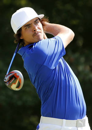 Photo -   Rickie Fowler tees off on the fourth hole during the Pro Am round of the Deutsche Bank Championship golf tournament at TPC Boston in Norton, Mass., Thursday, Aug. 30, 2012. (AP Photo/Michael Dwyer)