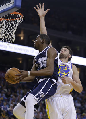 Photo - Oklahoma Thunder forward Kevin Durant (35) goes up for a shot against Golden State Warriors' Andrew Bogut during the first half of an NBA basketball game Thursday, April 11, 2013, in Oakland, Calif. (AP Photo/Ben Margot)