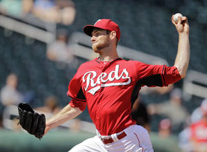 Photo - Cincinnati Reds starting pitcher Tony Cingrani delivers against the Arizona Diamondbacks in the seventh inning of a spring exhibition baseball game on Thursday, March 27, 2014, in Goodyear, Ariz. (AP Photo/Mark Duncan)