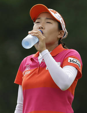 Photo - Korea's Ilhee Lee takes a drink of water during her second round at the Malaysian LGPA event in Kuala Lumpur, Friday, Oct. 11, 2013. (AP Photo/Mark Baker)