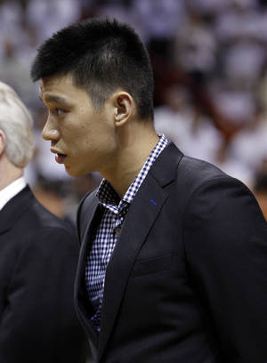 Photo -   New York Knicks' Jeremy Lin stands for the national anthem before an NBA basketball game against the Miami Heat in the first round of the Eastern Conference playoffs in Miami, Monday, April 30, 2012. (AP Photo/Lynne Sladky)