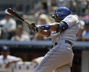 Photo - Toronto Blue Jays' Rajai Davis looks after a two-run double during the second inning of the baseball game against the New York Yankees at Yankee Stadium Tuesday, Aug. 20, 2013 in New York. (AP Photo/Seth Wenig)