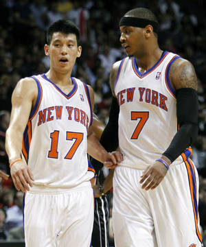 Photo -   FILE - In this Feb. 12, 2012, file photo, New York Knicks guard Jeremy Lin (17) and teammate Carmelo Anthony (7) talk during the first half of an NBA basketball game against the Miami Heat in Miami. Linsanity could be put to rest in New York when the clock strikes midnight. That's the deadline the Knicks face to match the daunting offer the Houston Rockets have made to Lin, the Harvard point guard who dazzled all of basketball for a brief stretch last season. (AP Photo/Alan Diaz, File)