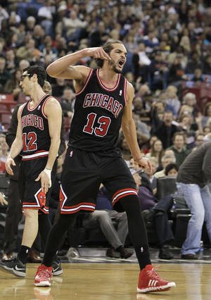 Photo - Chicago Bulls center Joakim Noah shouts after getting his second technical foul and was ejected from the game in the third quarter against the Sacramento Kings in a NBA basketball game in Sacramento, Calif., Monday, Feb. 3, 2014. The Kings won 99-70. (AP Photo/Rich Pedroncelli)