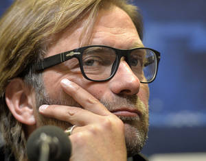 Photo - Dortmund head coach Juergen Klopp listens to the media during a press conference  prior the Champions League Group F soccer match between Borussia Dortmund and Olympique Marseille in Dortmund, Germany, Monday, Sept. 30, 2013. (AP Photo/Martin Meissner)