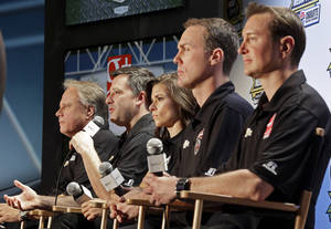 Photo - Driver/owner Tony Stewart, second from left, speaks as co-owner Gene Haas, left, and drivers, from right, Kurt Busch, Kevin Harvick and Danica Patrick listen during a news conference at the NASCAR Sprint Cup auto racing Media Tour in Charlotte, N.C., Monday, Jan. 27, 2014. (AP Photo/Chuck Burton)