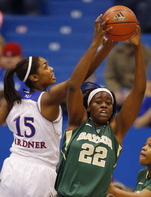 Photo - Baylor center Sune Agbuke (22) rebounds against Kansas forward Chelsea Gardner (15) during the first half of an NCAA college basketball game in Lawrence, Kan., Sunday, Jan. 19, 2014. (AP Photo/Orlin Wagner)