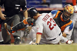 Photo -   St.Louis Cardinals' David Freese (32) is tagged out at home by Miami Marlins catcher John Buck during the first inning of a baseball game in Miami, Wednesday, June 27, 2012. (AP Photo/J Pat Carter)
