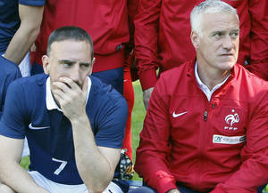 Photo - France's forward Franck Ribery, left, and head coach Didier Deschamps pose for the team picture at the French national football team's training base, in Clairefontaine, outside Paris, Friday, June 6, 2014 as part of France's national football team's preparation for the upcoming FIFA 2014 World Cup in Brazil.  Deschamps told a news conference that Ribery, 31, has been ruled out after injuring his lower back in a training session on Friday. (AP Photo/Francois Mori)