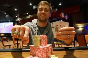 Photo - Tyler Morris shows off his Main Event championship ring. Photo courtesy WSOP. <strong></strong>