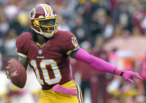 Photo -   Washington Redskins quarterback Robert Griffin III looks for an open man to throw to during the second half of an NFL football game against the Atlanta Falcons in Landover, Md., Sunday, Oct. 7, 2012. (AP Photo/Susan Walsh)