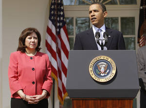 Photo - FILE - This April 15, 2010 file photo shows Labor Secretary Hilda Solis standing with President Barack Obama in the Rose Garden of the White House in Washington. Solis is telling colleagues she is leaving the Obama administration.  (AP Photo/Charles Dharapak, File)
