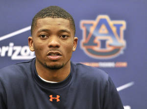 Photo - Auburn quarterback Nick Marshall (14) talks to the media  NCAA college football practice at the Auburn Athletic Complex Saturday, March 22, 2014, in Auburn, Ala. (AP Photo/AL.com, Julie Bennett) MAGS OUT