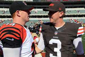 Photo -   Cincinnati Bengals quarterback Andy Dalton (14) meets with Cleveland Browns quarterback Brandon Weeden (3) after the Bengals' 34-27 win in an NFL football game, Sunday, Sept. 16, 2012, in Cincinnati. (AP Photo/David Kohl)