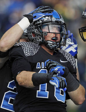 Photo -   Air Force wide receiver Drew Coleman celebrates his touchdown catch against Navy during the first quarter of an NCAA college football game at Air Force Academy, Colo., on Saturday, Oct. 6, 2012. (AP Photo/David Zalubowski)