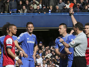 Photo - Referee Andre Marriner, in grey, sends off Arsenal's Kieran Gibbs, left, during their English Premier League soccer match between Chelsea and Arsenal at Stamford Bridge stadium in London Saturday, Mar  22  2014. (AP Photo/Alastair Grant)