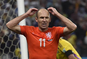 Photo - Netherlands' Arjen Robben reacts after missing a chance during the World Cup semifinal soccer match between the Netherlands and Argentina at the Itaquerao Stadium in Sao Paulo Brazil, Wednesday, July 9, 2014. (AP Photo/Martin Meissner)