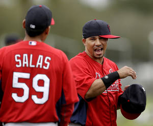 photo - St. Louis Cardinals shortstop Rafael Furcal, right, jokes with teammate relief pitcher Fernando Salas (59) during the team's first full squad workout at spring training baseball, Friday, Feb. 15, 2013, in Jupiter, Fla. (AP Photo/Julio Cortez)