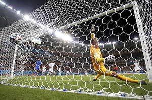 Photo - England's goalkeeper Joe Hart fails to stop a goal by Italy's Mario Balotelli's during the second half of the group D World Cup soccer match between England and Italy at the Arena da Amazonia in Manaus, Brazil, Saturday, June 14, 2014. The goal gave Italy a 2-1 win. (AP Photo/Marcio Jose Sanchez)