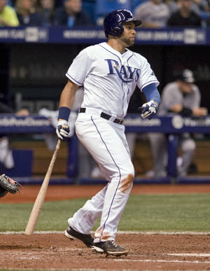 Photo - Tampa Bay Rays' James Loney watches a two-run single off New York Yankees reliever David Phelps during the seventh inning of a baseball game Friday, April 18, 2014, in St. Petersburg, Fla. (AP Photo/Steve Nesius)