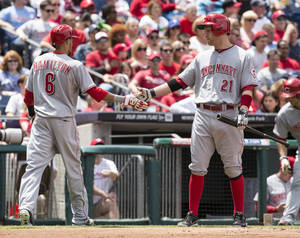 Photo - Cincinnati Reds' Billy Hamilton, left, celebrates scoring with teammate Todd Frazier, right, during the first inning of a baseball game against the Philadelphia Phillies, Sunday, May 18, 2014, in Philadelphia. (AP Photo/Chris Szagola)