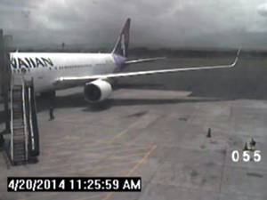 Photo - This April 20, 2014 image taken from a surveillance video provided by the Hawaii Department of Transportation, shows a California teen, left, after hopping from a jet's wheel well in Maui, Hawaii. Police said Tuesday, May 6, that they plan to interview the teen who stowed away on a Hawaii-bound flight two weeks ago, surviving sub-freezing temperatures as it crossed the Pacific Ocean. (AP Photo/Hawaii Department of Transportation)