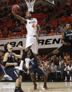 Photo - Oklahoma State's Brian Williams has been dating Cowgirls point guard Tiffany Bias for two years.  AP photo