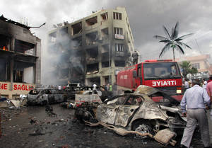 Photo - The site of one of the explosions after several explosions killed at least 40 people and injured dozens in Reyhanli, near Turkey's border with Syria, Saturday, May 11, 2013, Turkish Interior Minister Muammer Guler said. (AP Photo/IHA) TURKEY OUT
