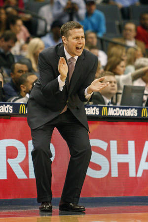 Photo - Memphis Grizzlies head coach Dave Joerger calls a play against the Milwaukee Bucks in the first half of an NBA basketball game on Saturday, Feb. 1, 2014, in Memphis, Tenn. (AP Photo/Lance Murphey)
