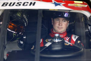 Photo - Kurt Busch waits in his car before practice for Sunday's NASCAR Sprint Cup series auto race at Charlotte Motor Speedway in Concord, N.C., Thursday, May 22, 2014. (AP Photo/Terry Renna)