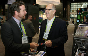 Photo - Tom Kupiec from DNA Solutions greets a visitor at last year's Biotechnology Industry Organization annual convention.  PHOTO PROVIDED <strong>unknown -  PROVIDED </strong>