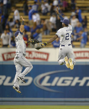 Photo -   San Diego Padres second baseman Alexi Amarista, left, celebrates with center fielder Cameron Maybin after they defeated the Los Angeles Dodgers 4-3 in their baseball game, Wednesday, Sept. 5, 2012, in Los Angeles. (AP Photo/Mark J. Terrill)