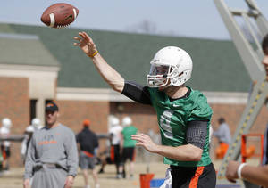 Photo - OKLAHOMA STATE UNIVERSITY / OSU / COLLEGE FOOTBALL: Oklahoma State quarterback J.W. Walsh throws a pass as offensive coordinator Mike Yurcich watches during an OSU spring football practice in Stillwater, Okla., Wednesday, March 13, 2013. Photo by Bryan Terry, The Oklahoman