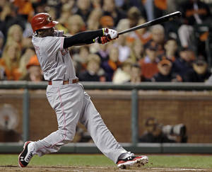photo -   Cincinnati Reds' Brandon Phillips swings on a two-run home run in the third inning of Game 1 of the National League division baseball series against the San Francisco Giants in San Francisco, Saturday, Oct. 6, 2012. (AP Photo/Eric Risberg)
