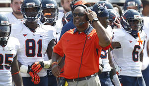 photo -   Virginia head coach Mike London watches from the sideline during the second half on an NCAA college football game against TCU, Saturday, Sept. 22, 2012, in Fort Worth, Texas. TCU won 27-7, (AP Photo/LM Otero)
