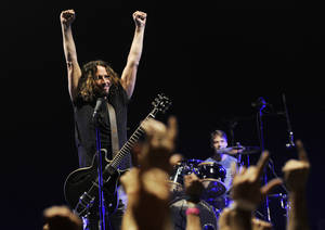 Photo - FILE - This Feb. 15, 2013 file photo shows Chris Cornell of Soundgarden during the band's concert at the Wiltern in Los Angeles. Soundgarden will perform at the iTunes Music Festival at SXSW on March 13, in celebration of the 20th Anniversary of Superunknown LP.(Photo by Chris Pizzello/Invision/AP, File)