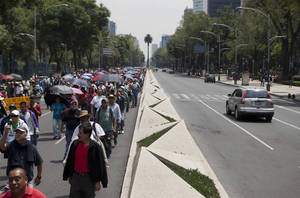 Photo - Public school teachers march Wednesday to Los Pinos presidential residence as they block vehicular access to Paseo de la Reforma, a main artery in Mexico City. AP Photo