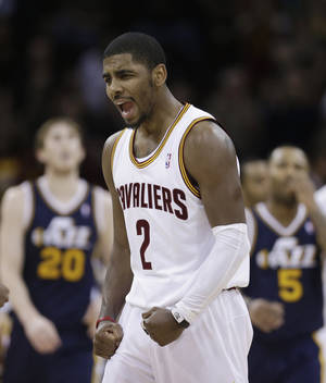 Photo - Cleveland Cavaliers' Kyrie Irving reacts late in the fourth quarter during an NBA basketball game against the Utah Jazz on Wednesday, March 6, 2013, in Cleveland. The Cavaliers won 104-101. (AP Photo/Tony Dejak)